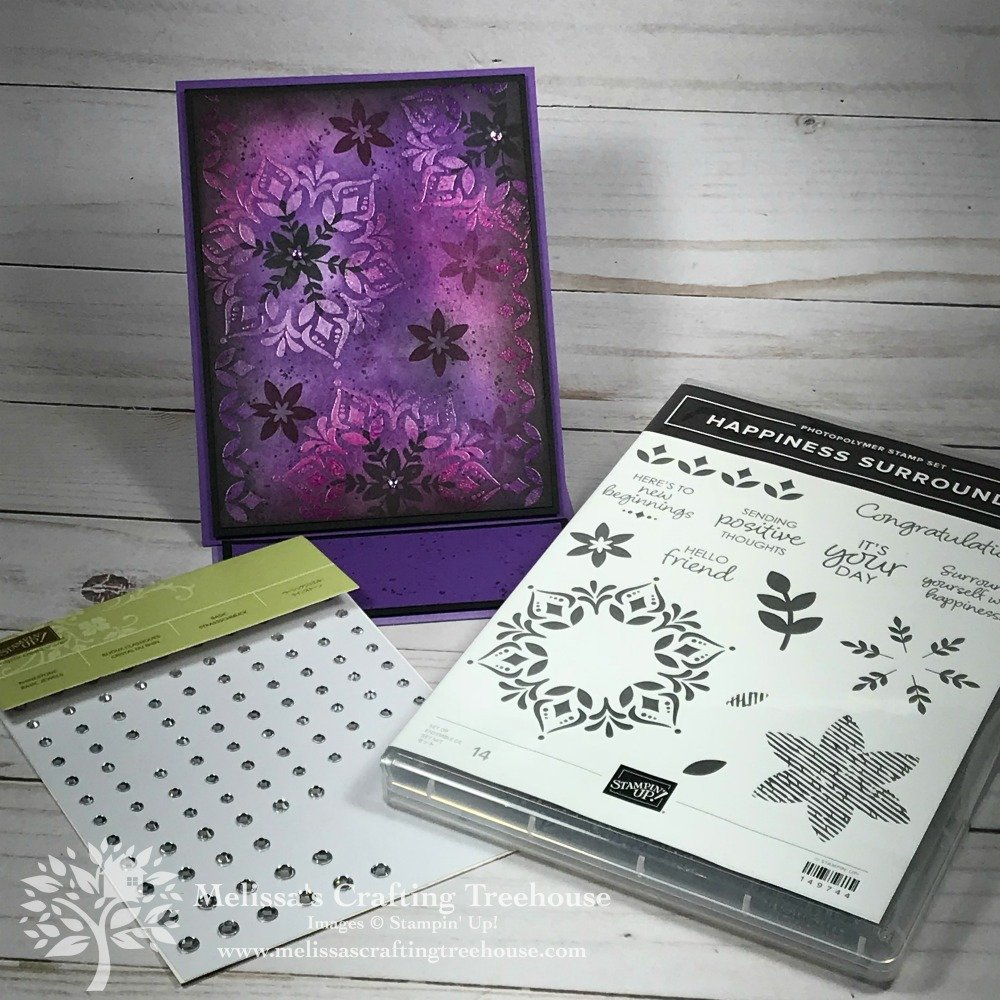 Check out this card featuring sponge art and the emboss resist technique. This project is made with the Happiness Surrounds Stamp Set by Stampin' Up!. Only available for a limited time or while supplies last!